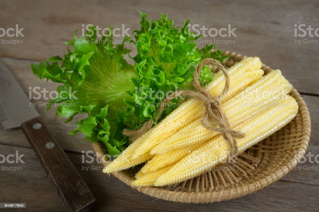 Baby corn with vegetable in basket. stock photo
