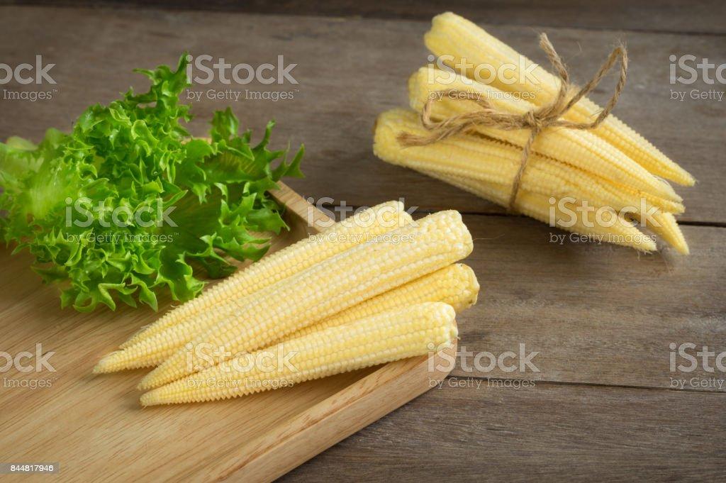 Baby corns on cutting board. stock photo