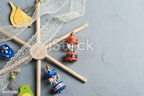 508167718 istock photo baby crib mobile with wooden colorful birds 624215862