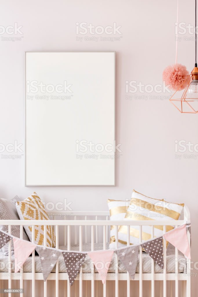 Baby crib with white poster mockup stock photo