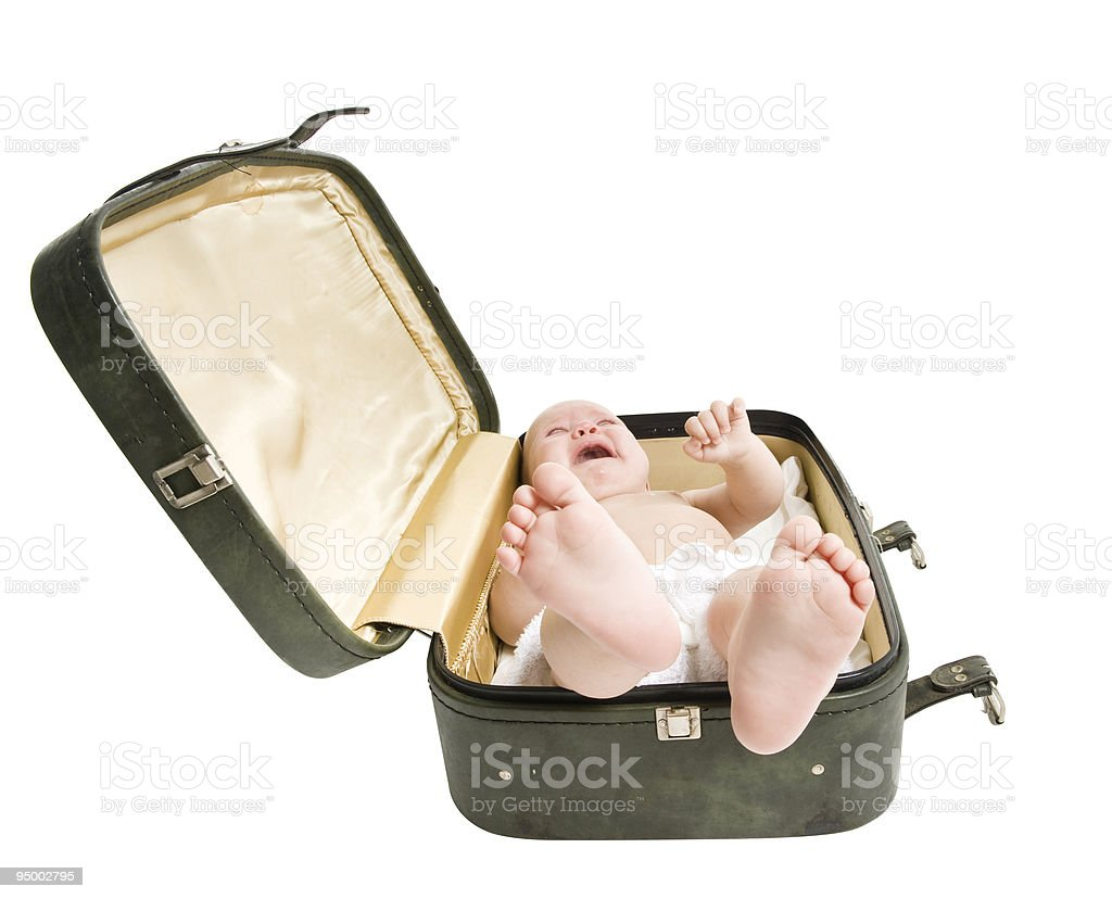 Baby crying in suitcase royalty-free stock photo