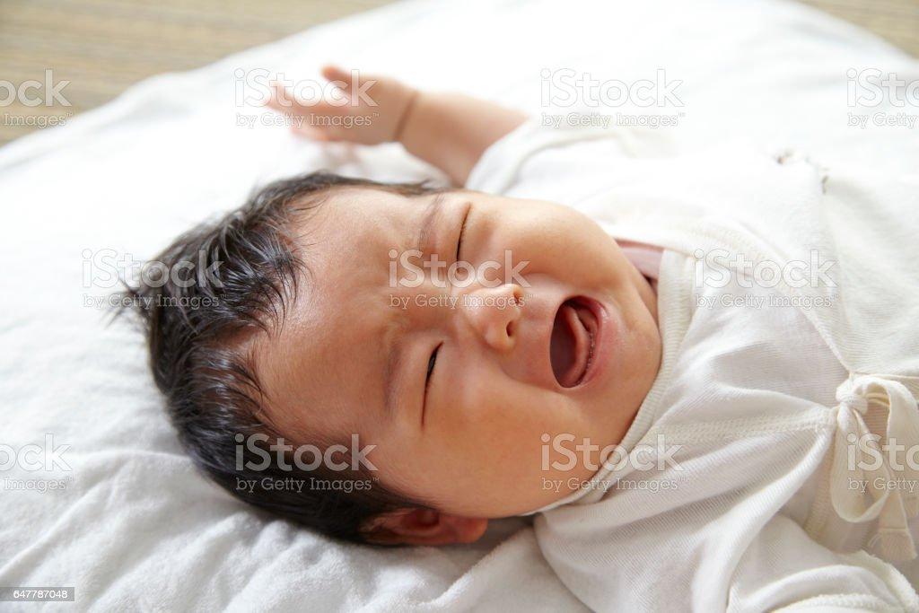 Baby crying Japanese girl stock photo