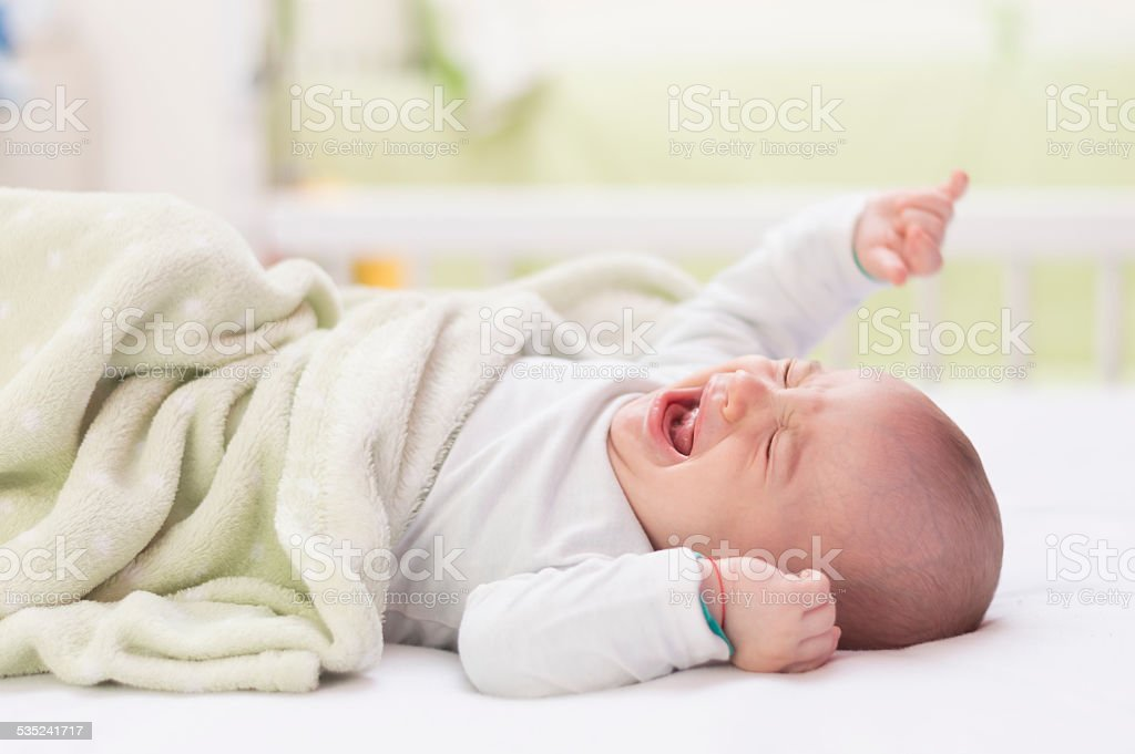 Baby crying stock photo