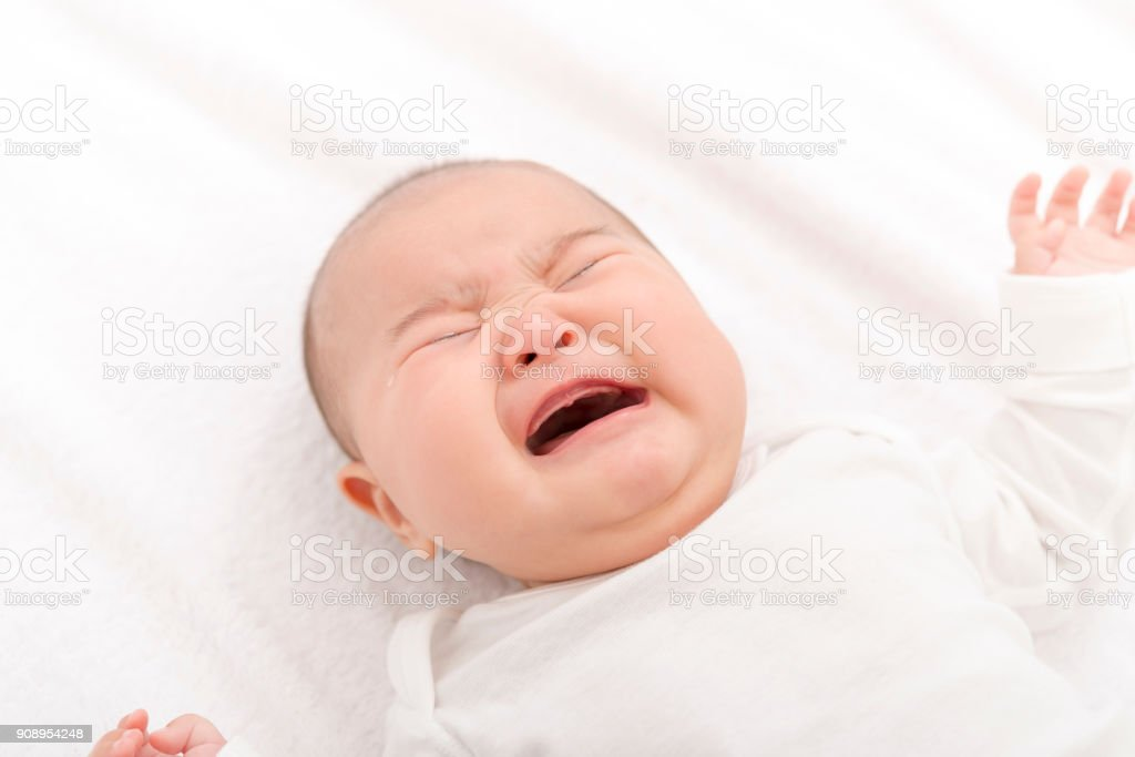 Baby crying with tears stock photo