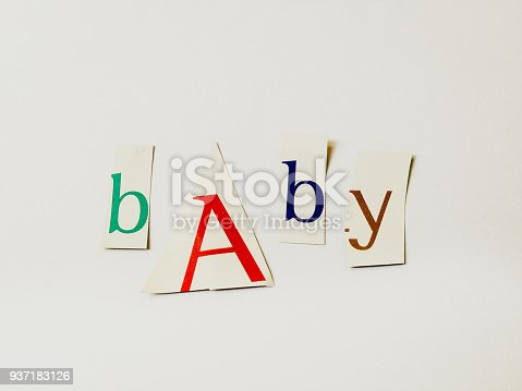 812461124 istock photo Baby - Cutout Words Collage Of Mixed Magazine Letters with White Background 937183126