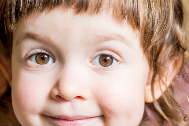 baby dark brown eyes close-up. Look straight into the lens stock photo