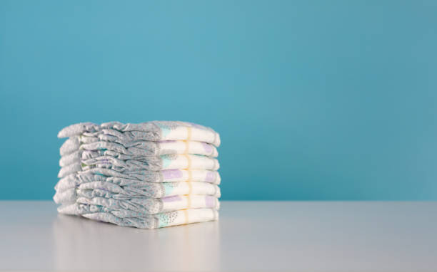 Baby diapers on blue background. stock photo