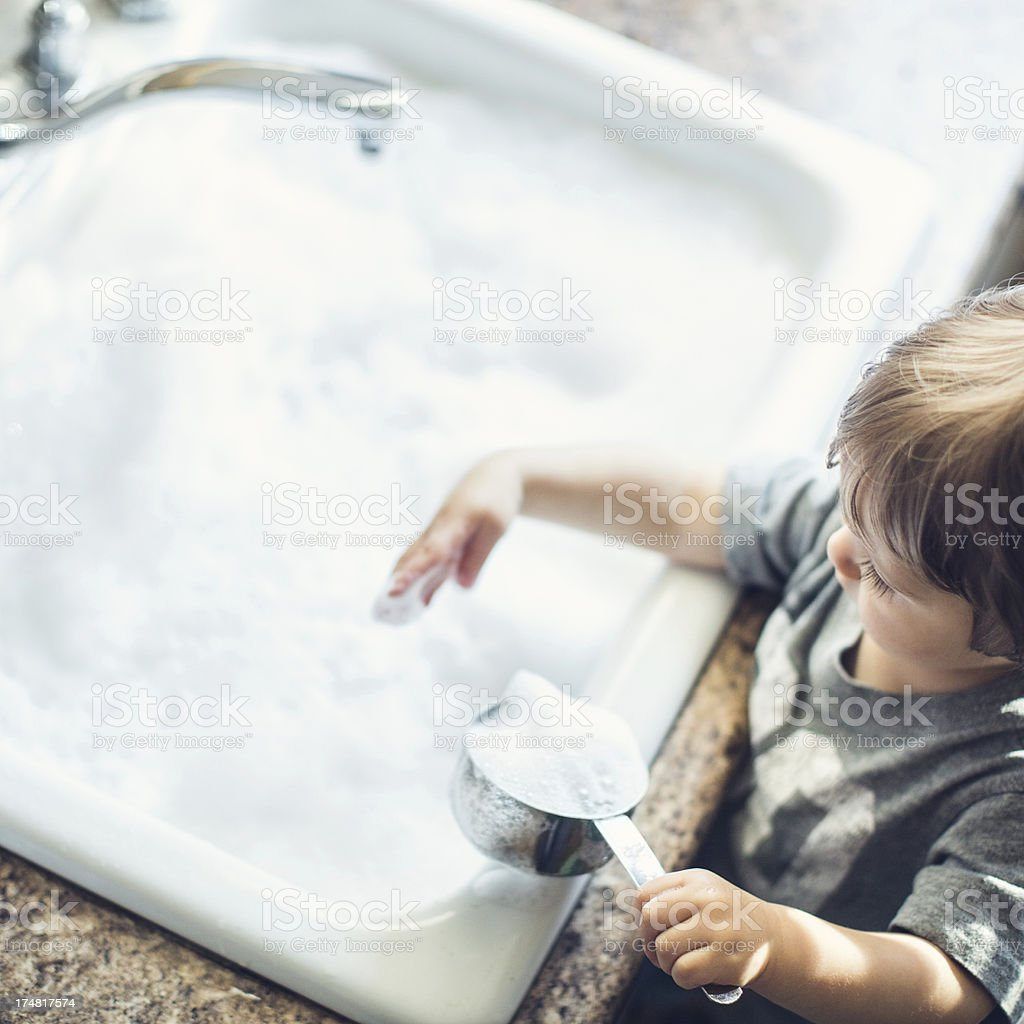Baby Dish Washing stock photo