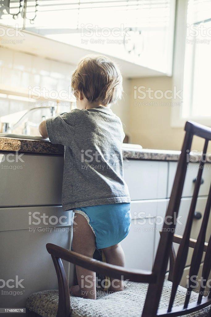 Baby Dish Washing royalty-free stock photo