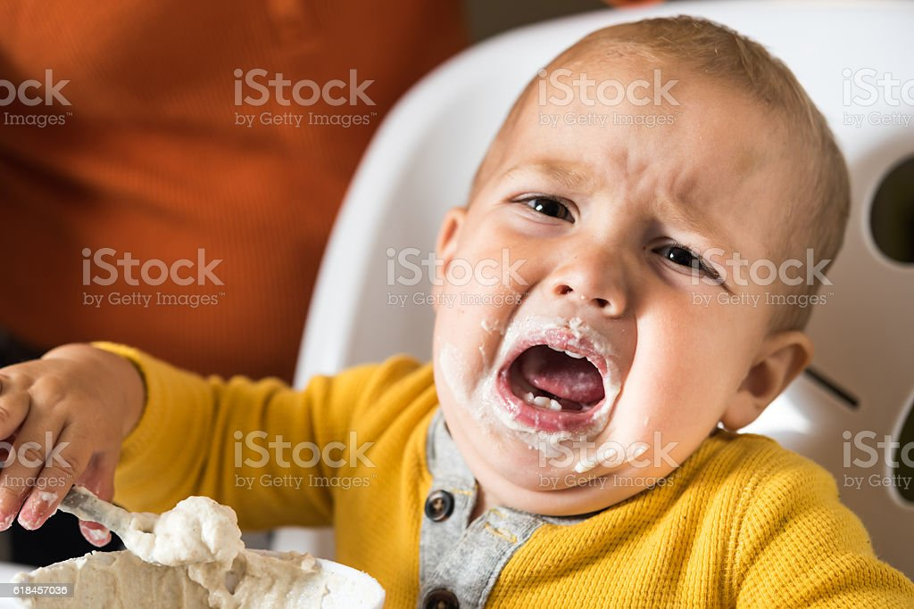 Baby does not want to eat stock photo