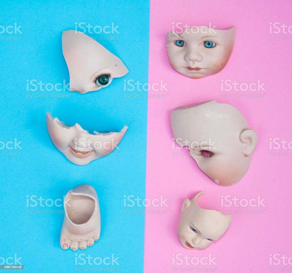 Baby Doll Head, Arms, Face on Blue and Pink Background stock photo