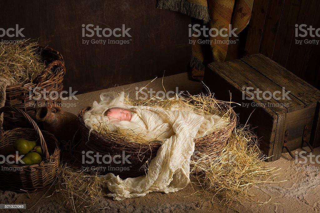 Baby doll in nativity scene stock photo