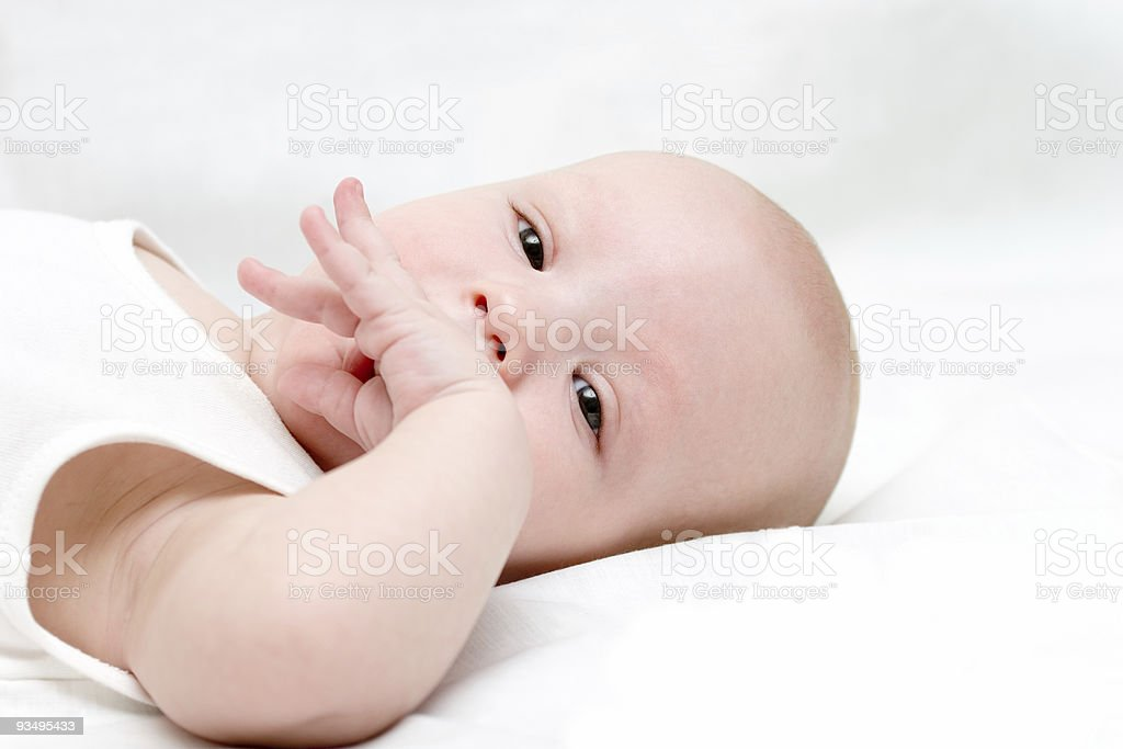 Baby draw your fist into the mouth #2 royalty-free stock photo