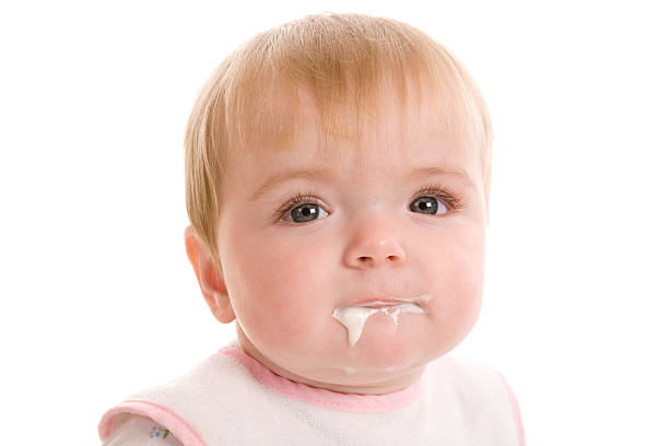 baby dribbling food - human saliva stock pictures, royalty-free photos & images