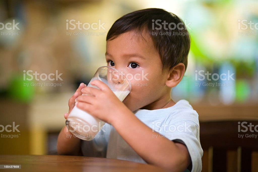 Baby drinking milk royalty-free stock photo
