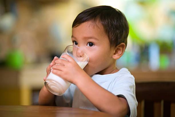 Baby drinking milk stock photo