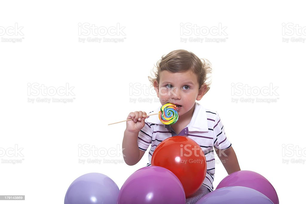 Baby eating a lollipop royalty-free stock photo