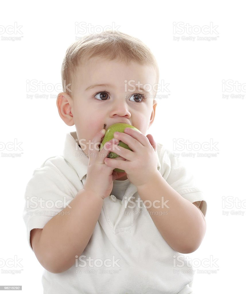 baby eating an apple royalty-free stock photo
