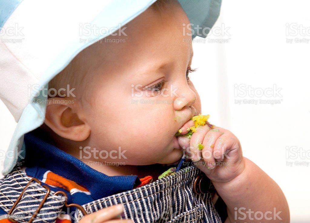 Baby eating cake royalty-free stock photo