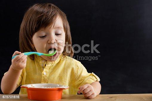 176993221istockphoto Baby eating feed. 675701616