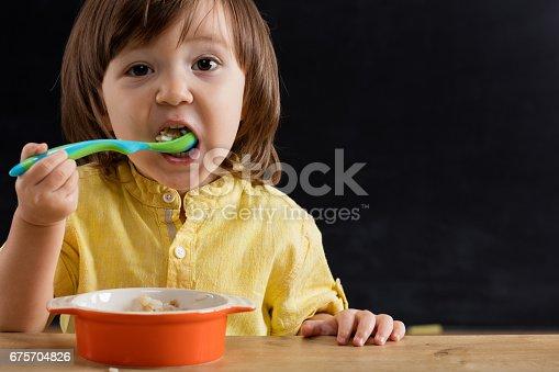 176993221istockphoto Baby eating feed. 675704826