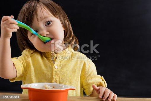 176993221istockphoto Baby eating feed. 675706384