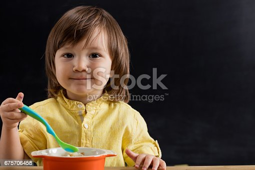 176993221istockphoto Baby eating feed. 675706458