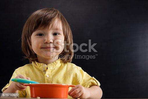 176993221istockphoto Baby eating feed. 675710972