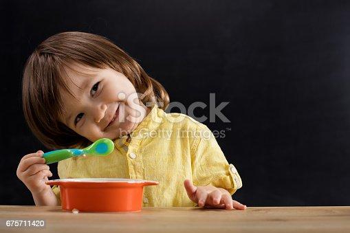 176993221istockphoto Baby eating feed. 675711420