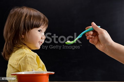 176993221istockphoto Baby eating feed. 675711564
