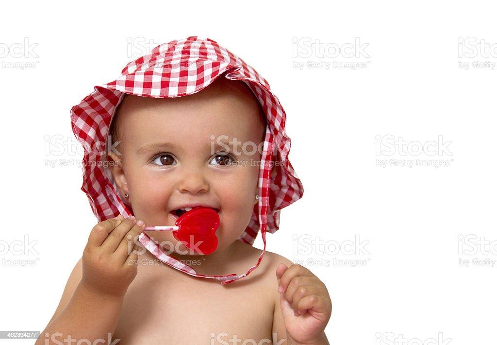 baby eating lollipop stock photo