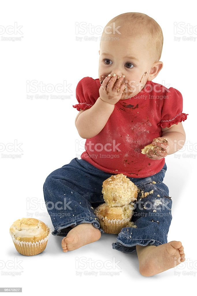 Baby Eating Muffins royalty-free stock photo