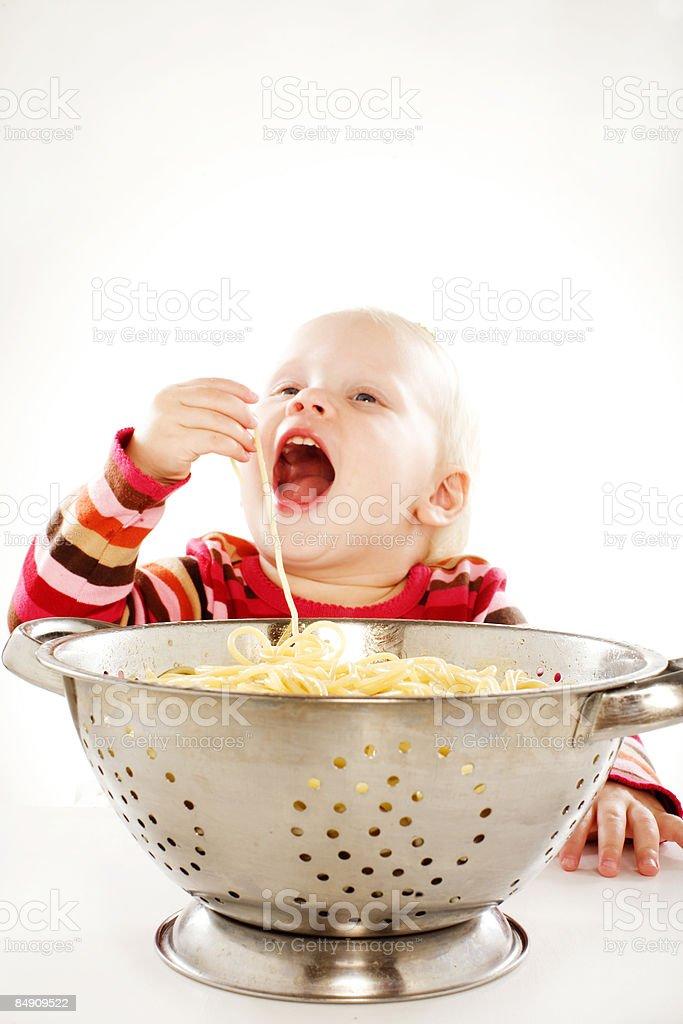baby eating spaghetti royalty-free stock photo