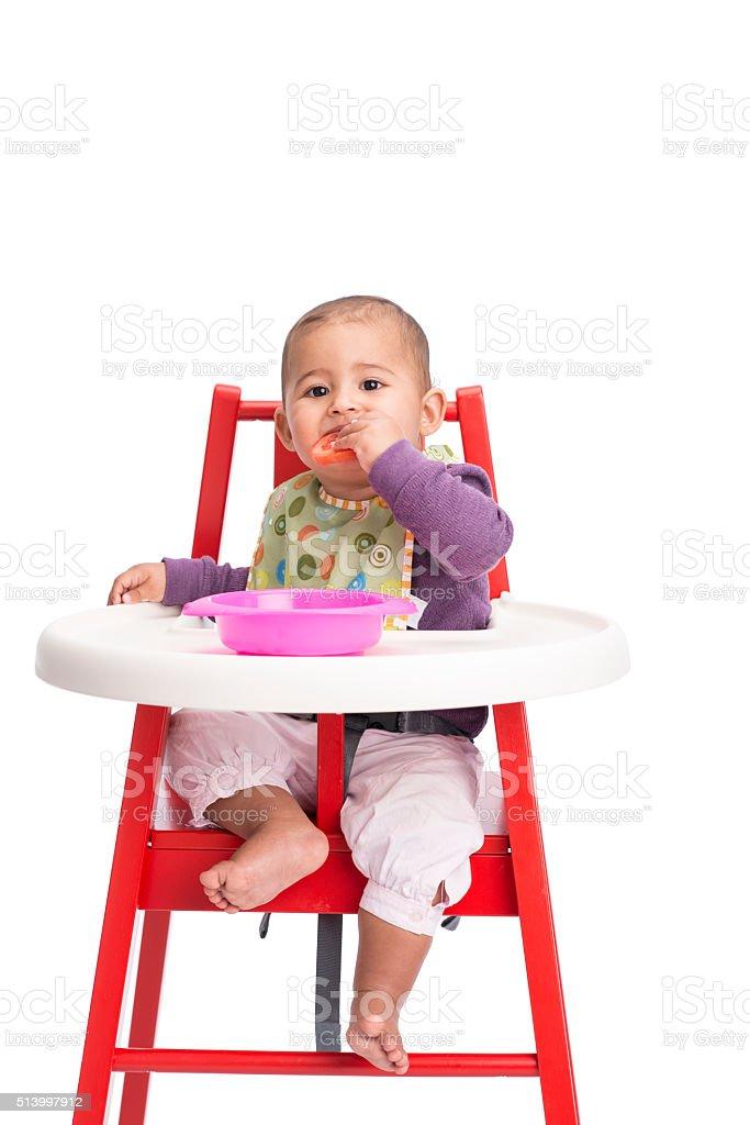 Baby eating tomato. stock photo