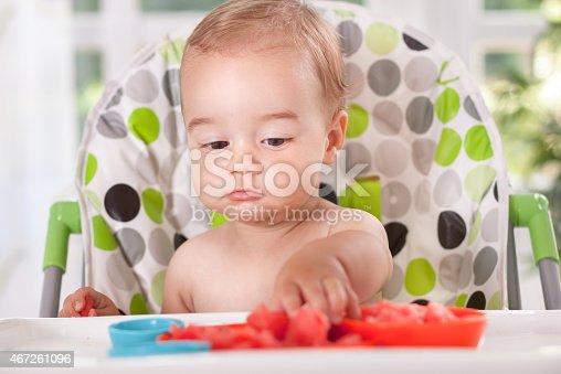 149051793 istock photo Baby eating watermelon with hands 467261096