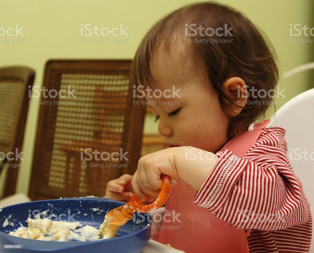 Baby eats with spoon. royalty-free stock photo