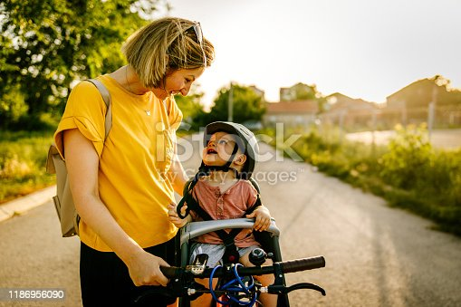 istock Baby enjoys bicycle ride with his mom 1186956090