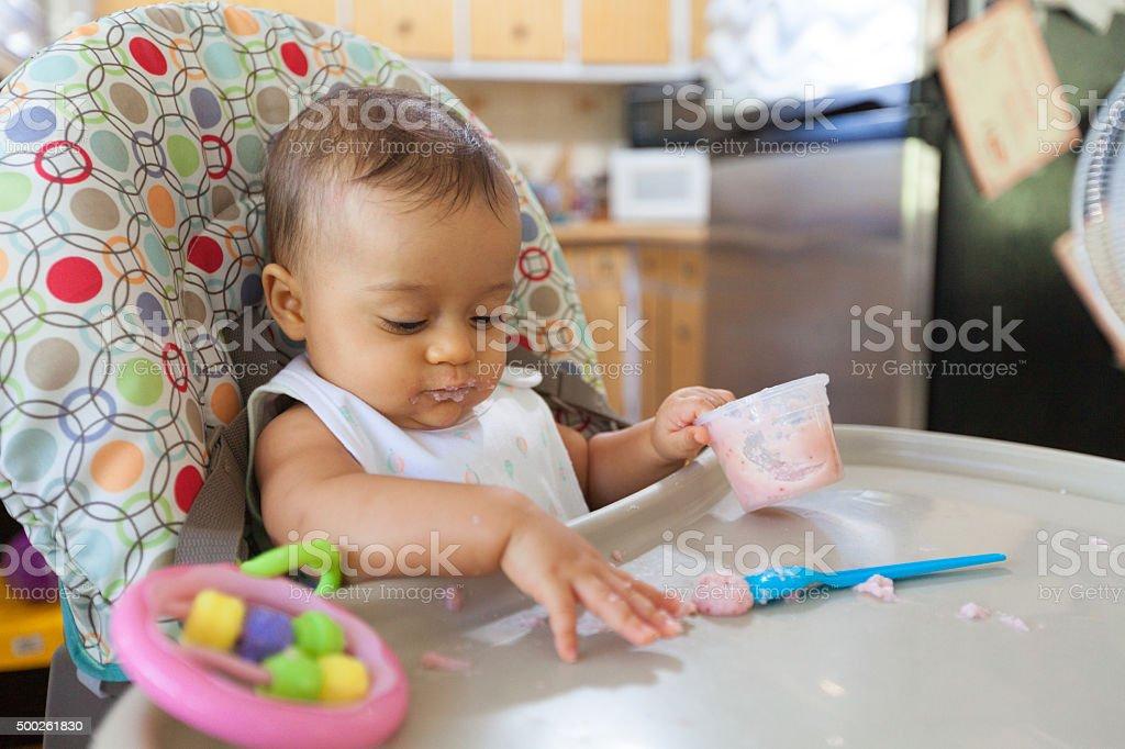 Baby feeding stock photo