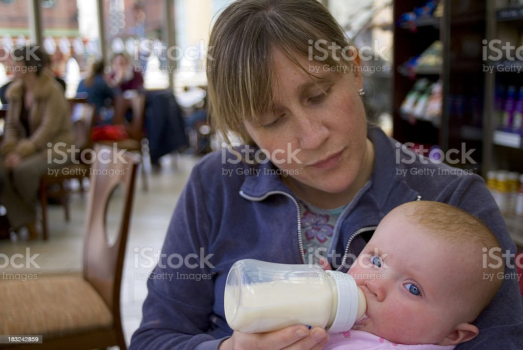 Baby feeding time in cafe stock photo