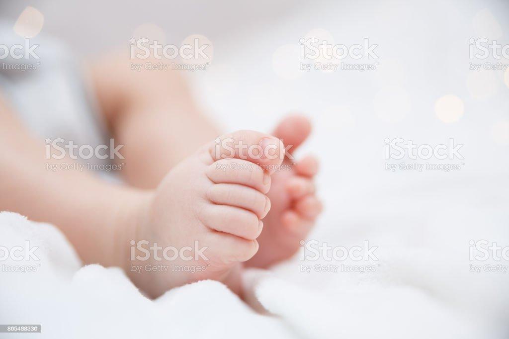 Baby feet closeup Baby feet closeup Baby - Human Age Stock Photo