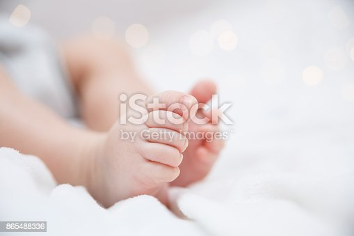 istock Baby feet closeup 865488336
