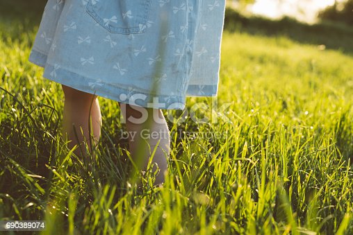 istock Baby feet in grass 690389074