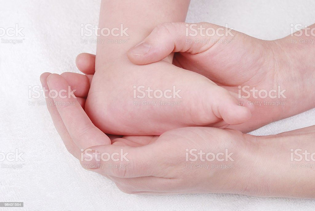 Baby feet in mommy's hands royalty-free stock photo