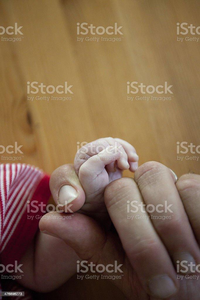 baby fingers stock photo