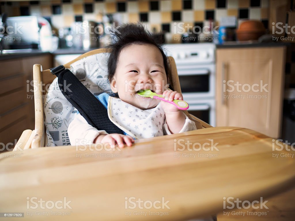 baby first weaning stock photo