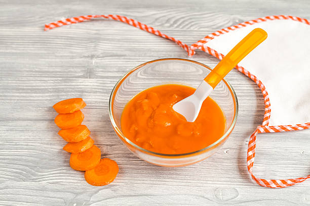 Baby food carrot puree on wooden background picture id625380964?b=1&k=6&m=625380964&s=612x612&w=0&h=ius i9m6msmwpc1z pqalmryiy gbs6qulya0mjrwte=
