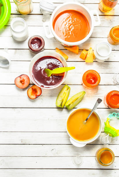 Baby food. Various baby purees from fresh vegetables and fruits. stock photo
