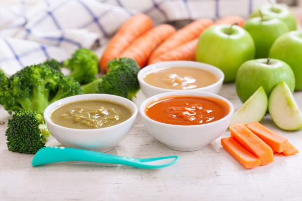 Baby food. Various bowls of fruit and vegetable puree stock photo
