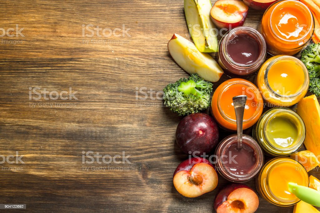 Baby food. Various purees of fruits and vegetables. stock photo