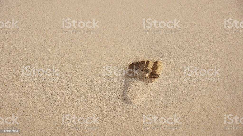 Baby footprint in the sand stock photo